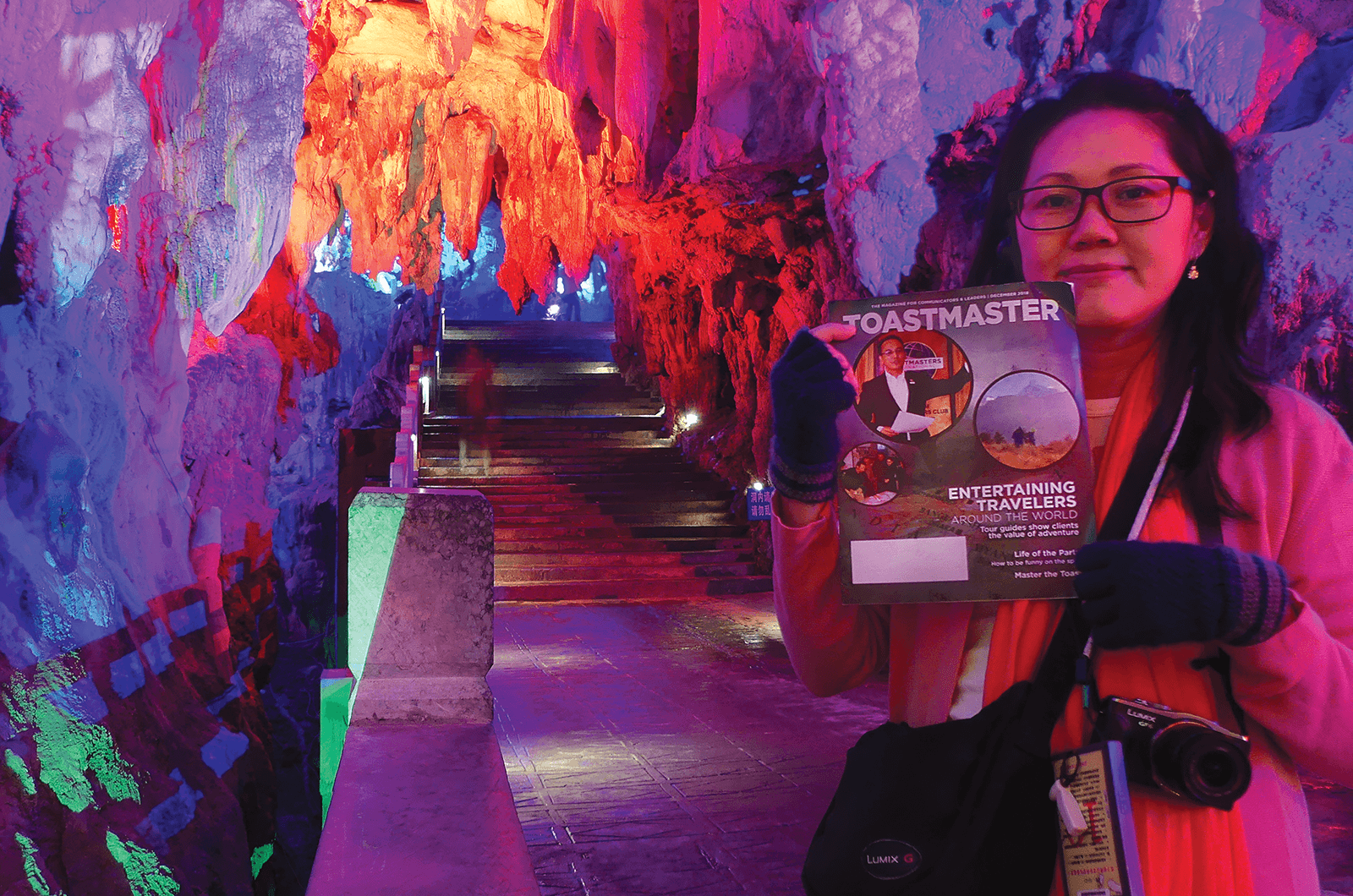 Eve Wong of Selangor, Malaysia, walks through dramatically-lit stalactites in the Silver Cave—a multilevel cave meandering through 12 mountain peaks—in Guilin City, Guangxi Province, China.