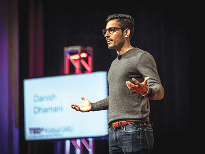 Danish Dhamani speaks onstage at TEDx
