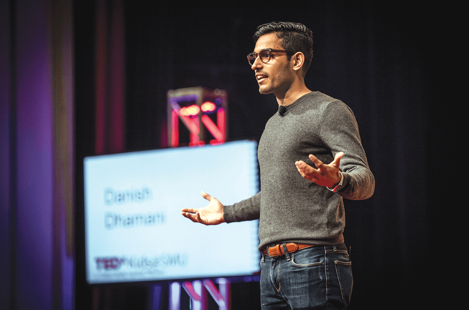 Danish Dhamani speaks onstage at TEDx
