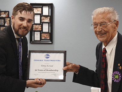 Mitchell Kent presents Tony Kowal with certificate