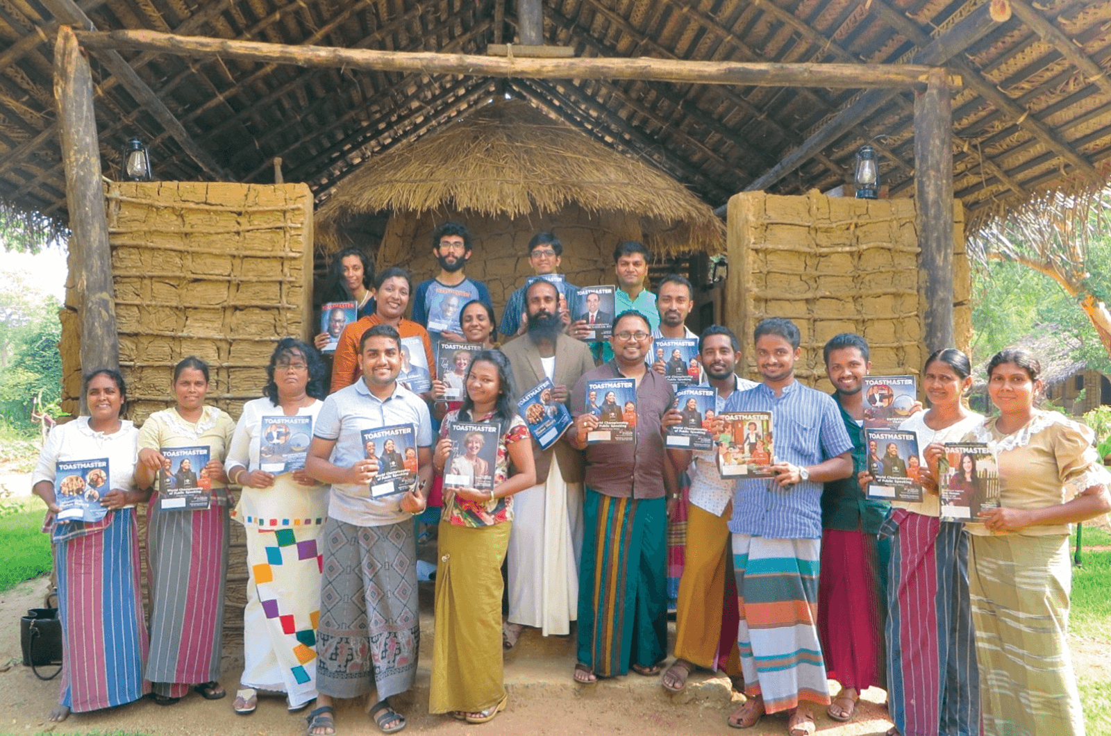 Toastmasters group pose in ancient village in Puranagama, Sri Lanka