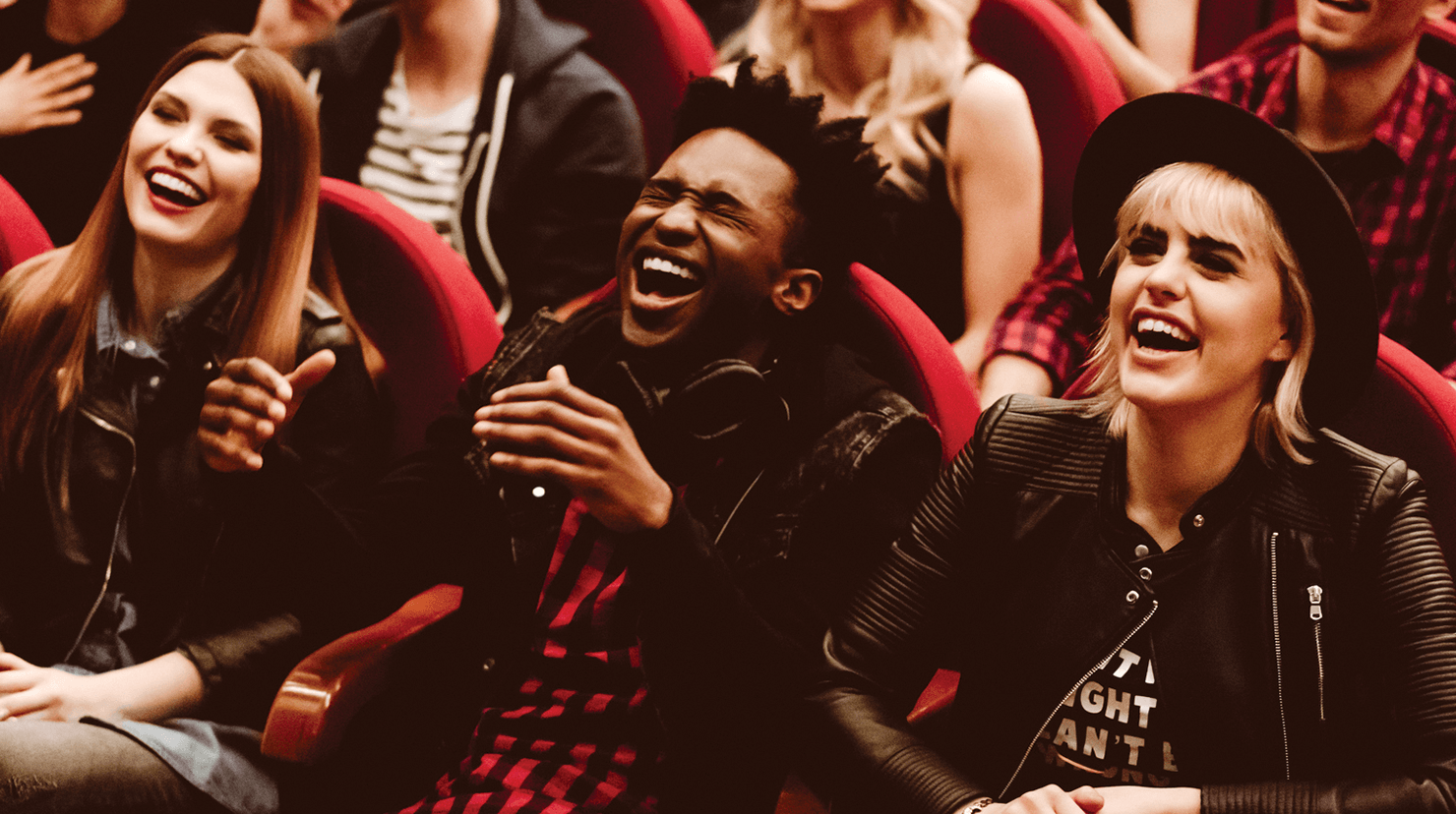 People sitting in audience laughing