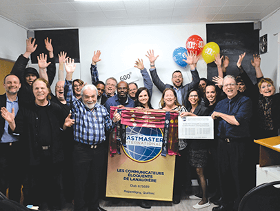 Group of Toastmasters member with hands in the air celebrating in Canada