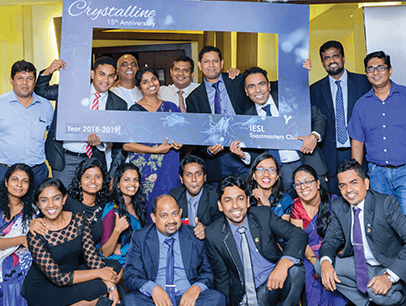 Group of Toastmasters in Sri Lanka pose with sign