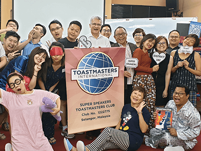 Toastmasters dressed in sleepwear during themed meeting