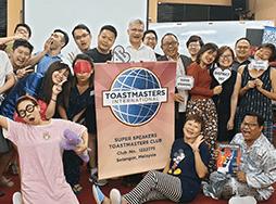 Toastmasters dressed in sleepwear during themed meeting