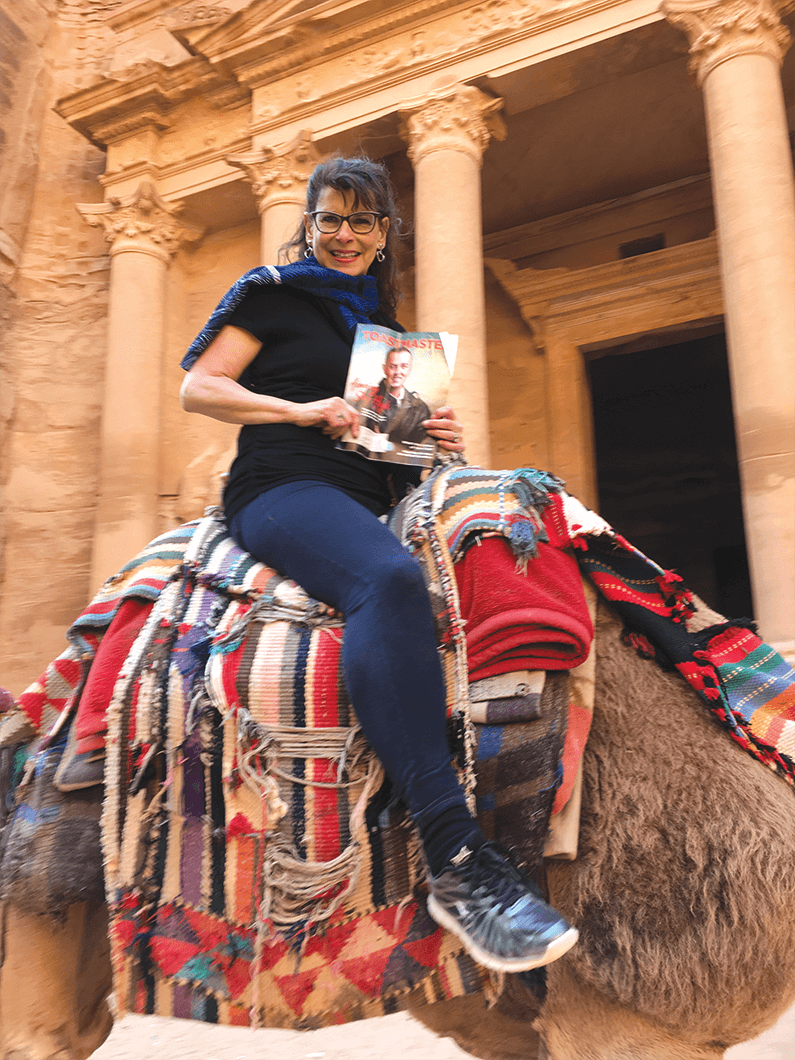 Annette Palmer of Brunswick, Ohio, travels by camel through Petra, Jordan,  nicknamed the Rose-Red City for the color of the rock from which many of the city's structures were carved.