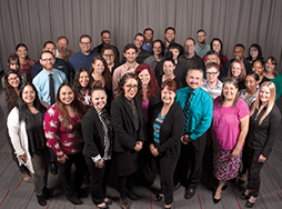 Toastmasters International World Headquarters Member Support staff posing in group photo