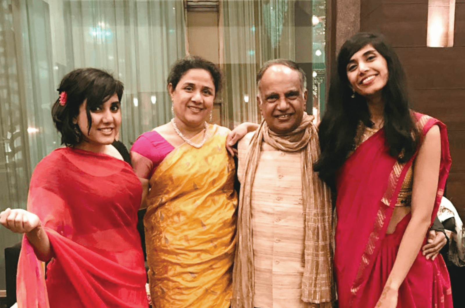 The Menons and their daughters, Ramita, left, and Rajita.