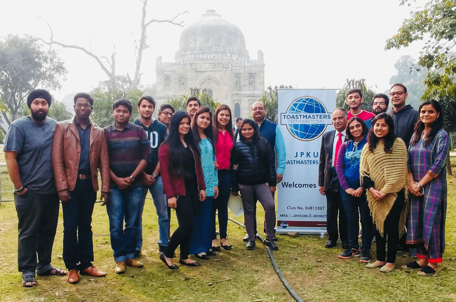 International President Deepak Menon poses with members of the JPKU Toastmasters club in New Delhi, India.