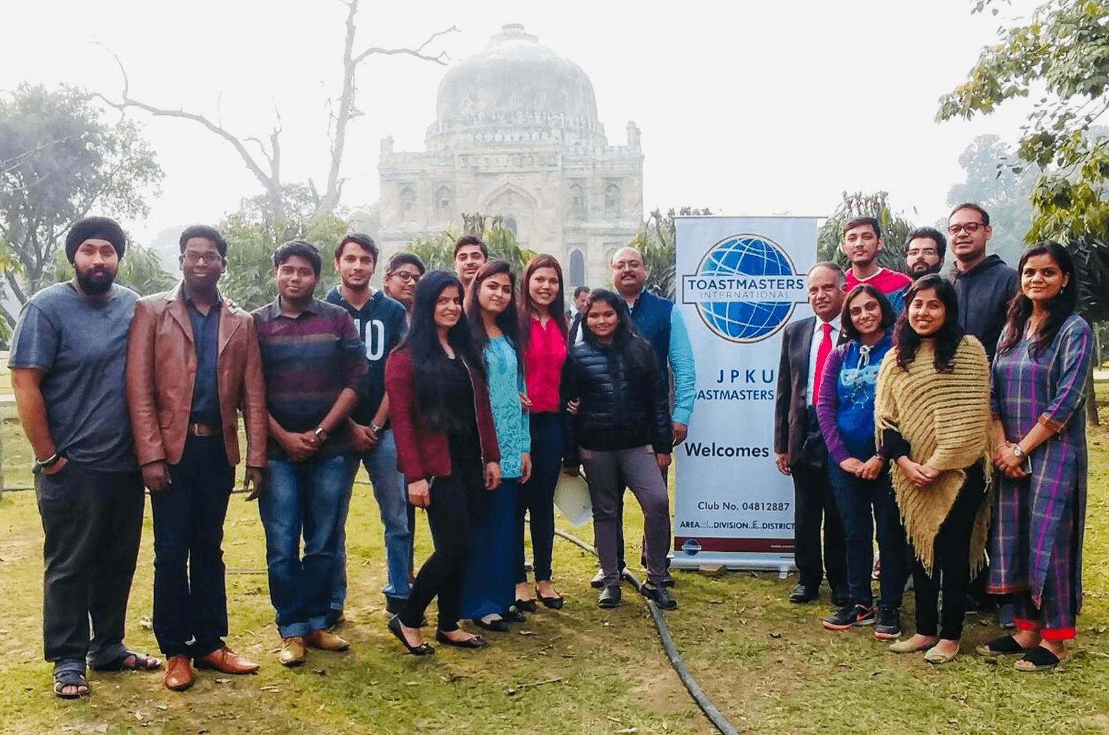International President Deepak Menon poses with members of the JPKU Toastmasters club in New Delhi, India.