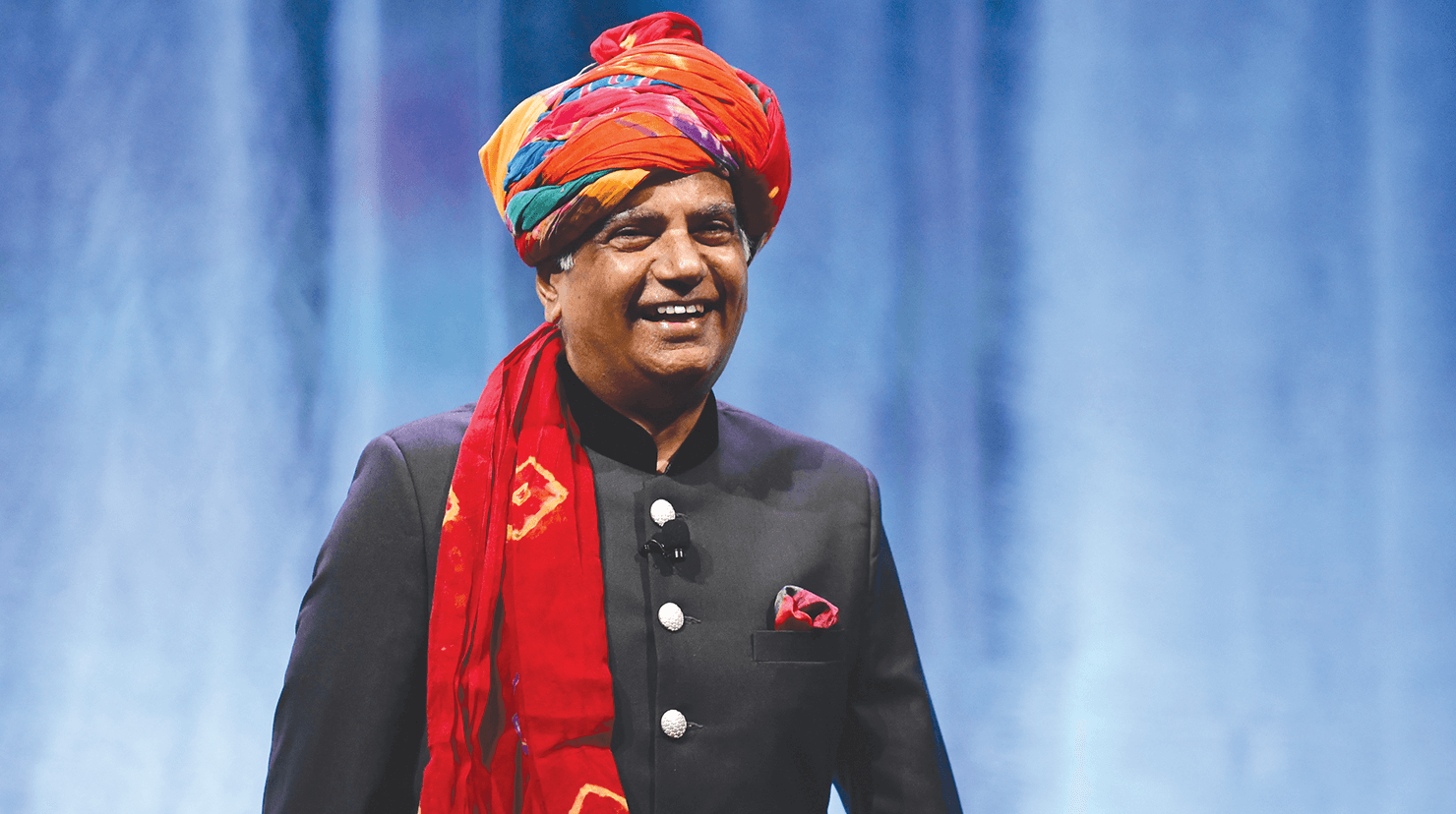 Toastmasters International President Deepak Menon smiling onstage
