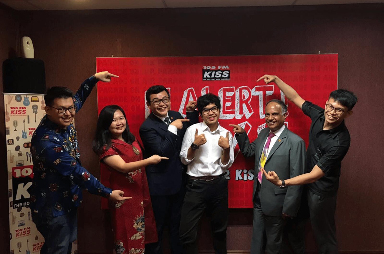 Deepak visits club members at a radio station Indonesia.