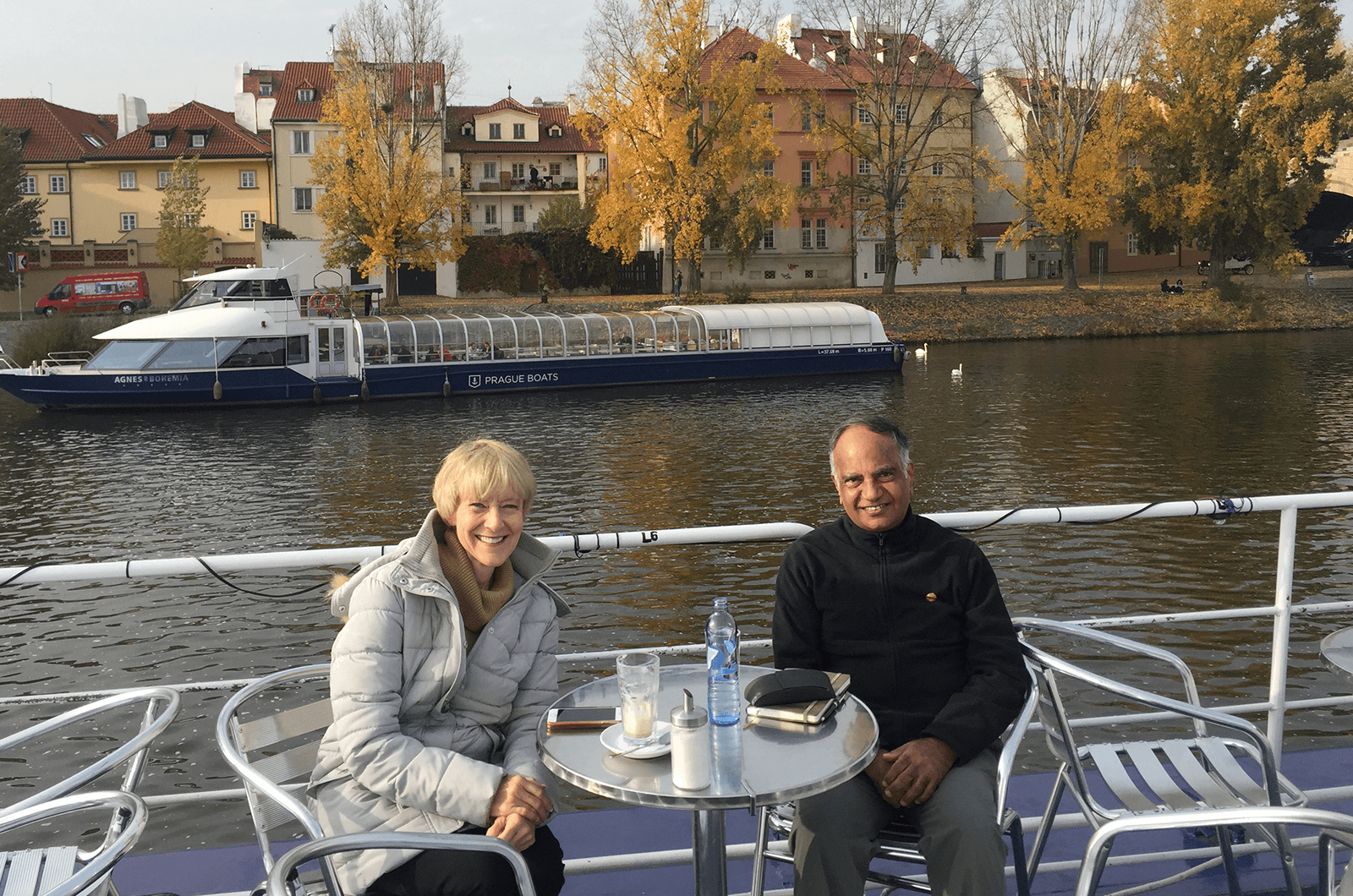 Immediate Past International President Lark Doley, left, and new International President Deepak Menon enjoy a conversation while in Prague.