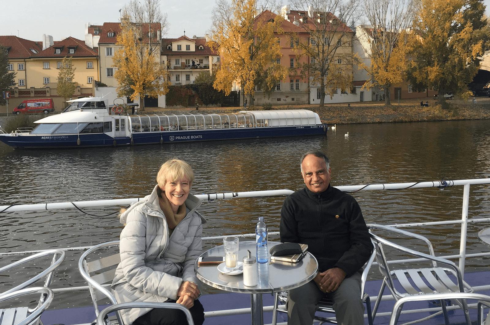 Immediate Past International President Lark Doley, left, and new International President Deepak Menon enjoy a conversation while in Prague.