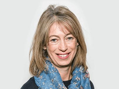 Woman smiling wearing blue scarf