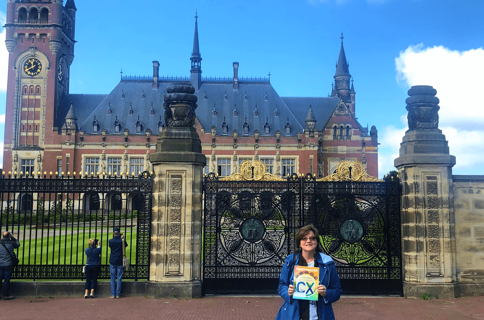 Andrea Patton of Houston, Texas, poses in front of the Peace Palace in The Hague, Netherlands. The Palace officially opened in 1913 and still houses the Permanent Court of Arbitration and the International Court of Justice.