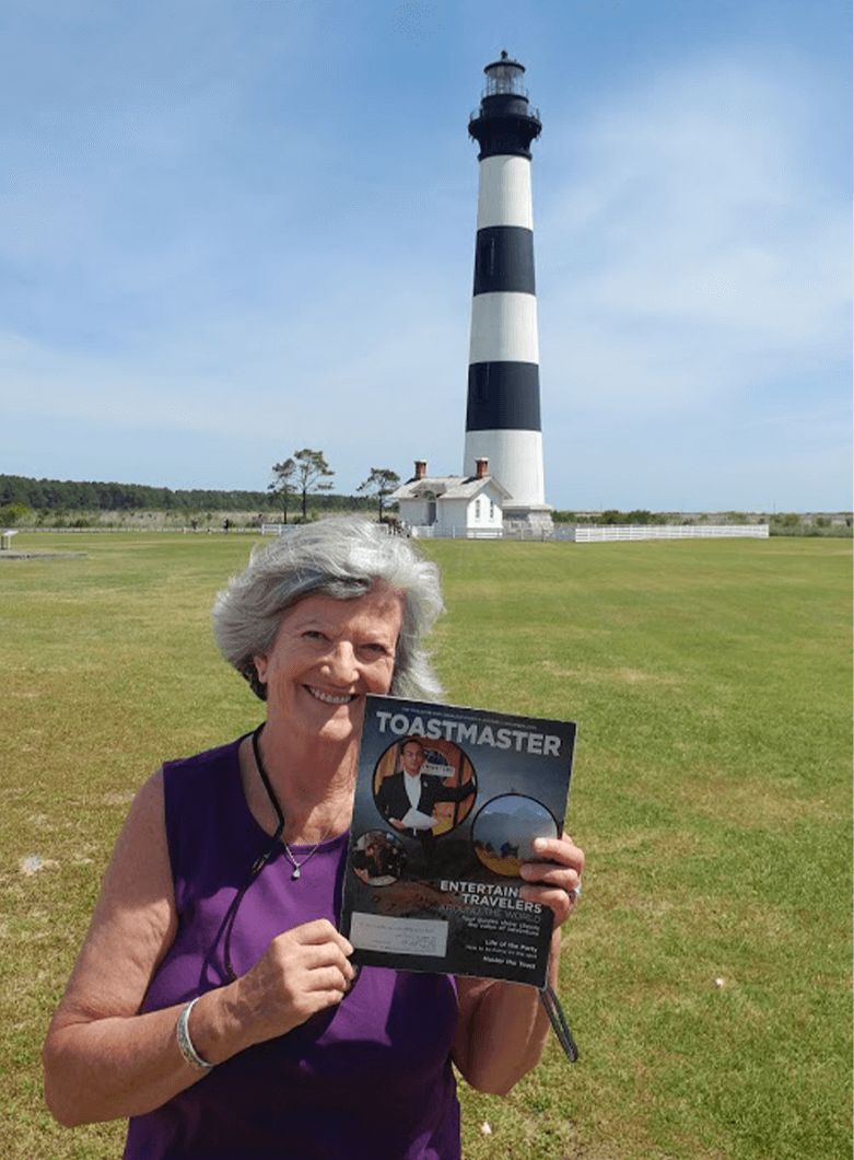 Carol Finley of Oak Ridge, Tennessee stands in front of the Bodie Island Lighthouse in Nags Head, North Carolina.