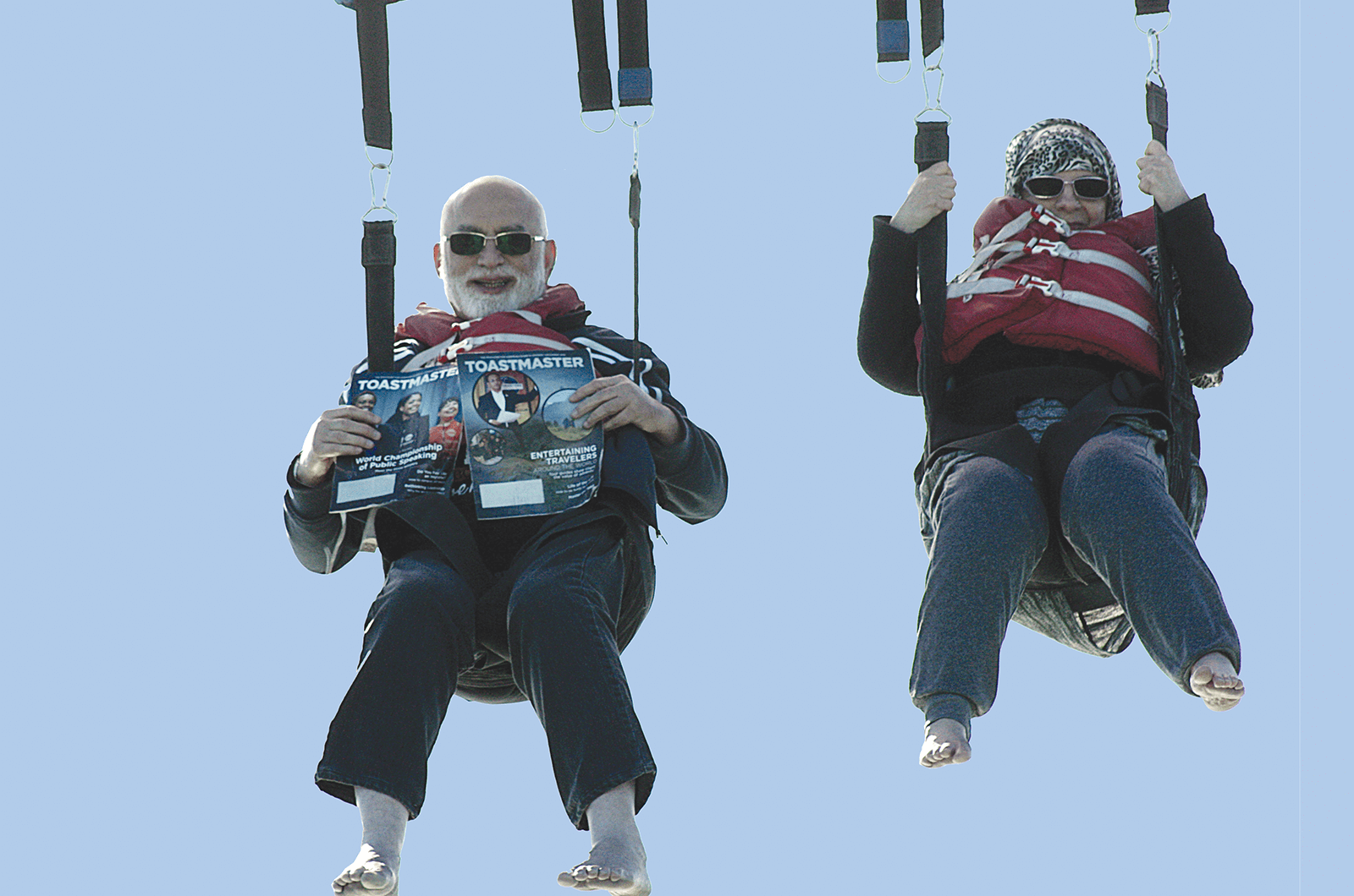 Mohomed Ikhlas Farid, DTM, and his wife, SHAISTA, of Doha, Qatar, take the Toastmaster to new heights while parasailing in Cape Canaveral, Florida.