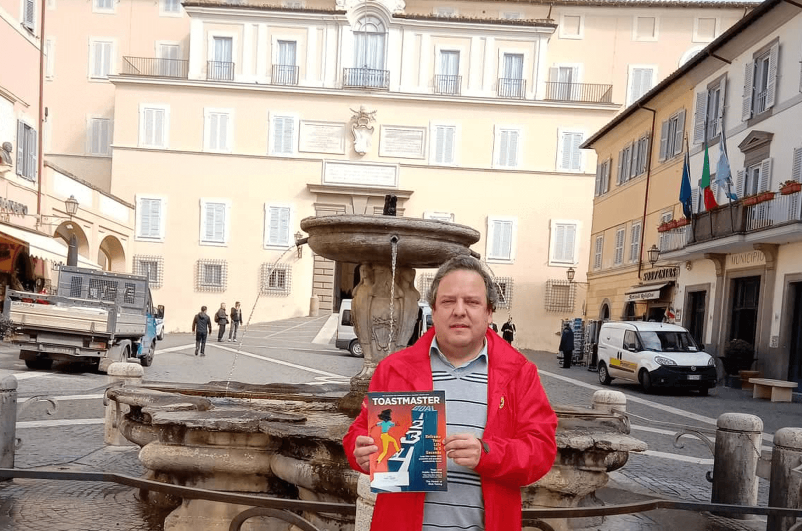 Ricardo Gama of Riachos, Portugal, pauses for a photo with the Apostolic Palace of Castel Gandolfo, Italy—the vacation retreat for the Catholic pope.