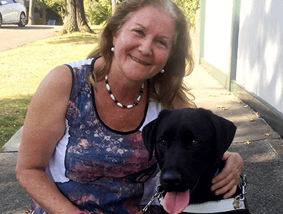 Blind woman with guide dog