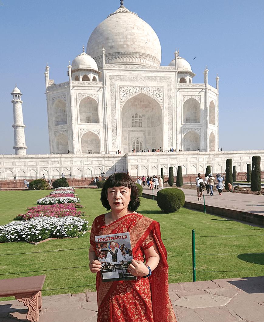 Keiko Miyake, DTM, of Shimonoseki, Japan, wears a sari to visit the Taj Mahal in Agra, India.