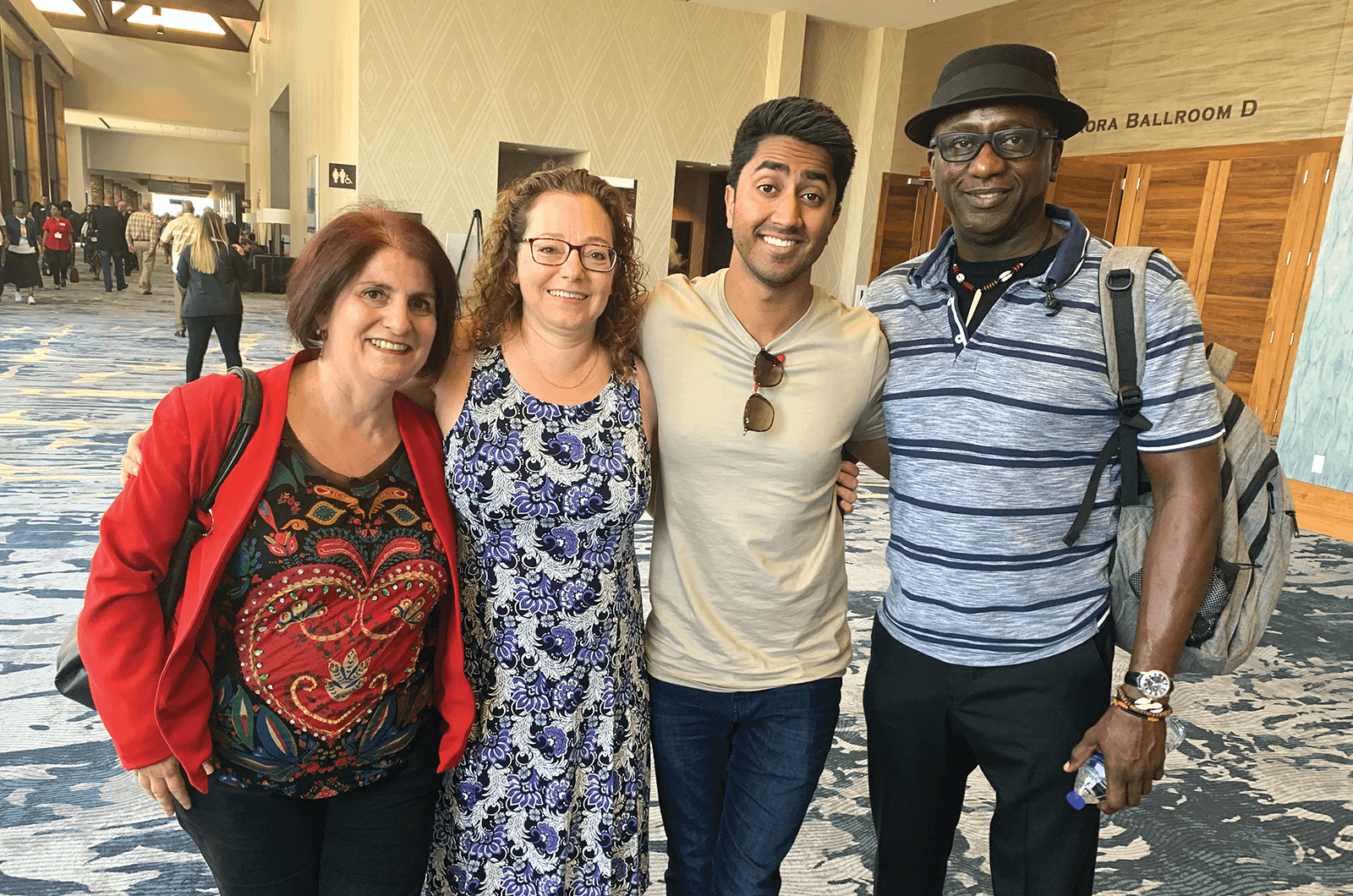 Four people pose together at annual convention