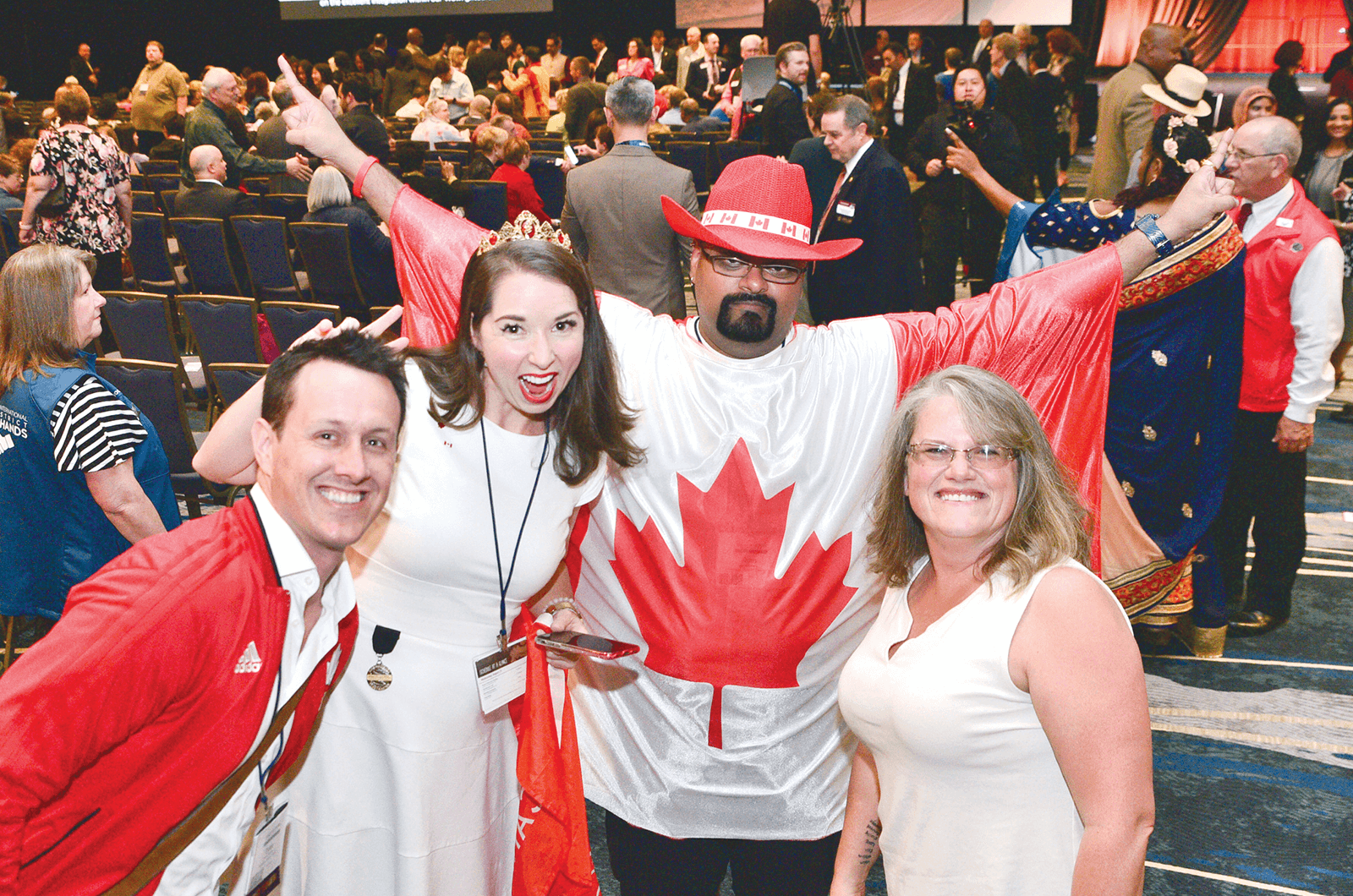 Canadian Toastmasters celebrate before Opening Ceremonies begin.