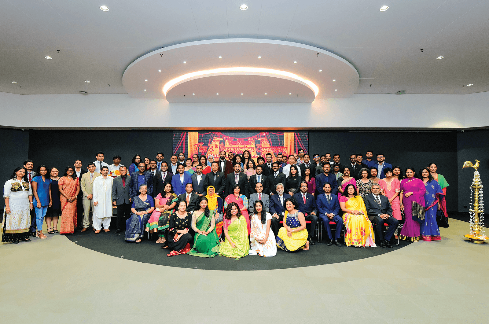 Group of Toastmasters members dressed in Bollywood-themed attire