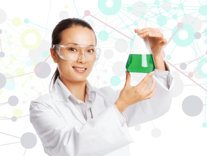 Woman in white lab coat holding beaker