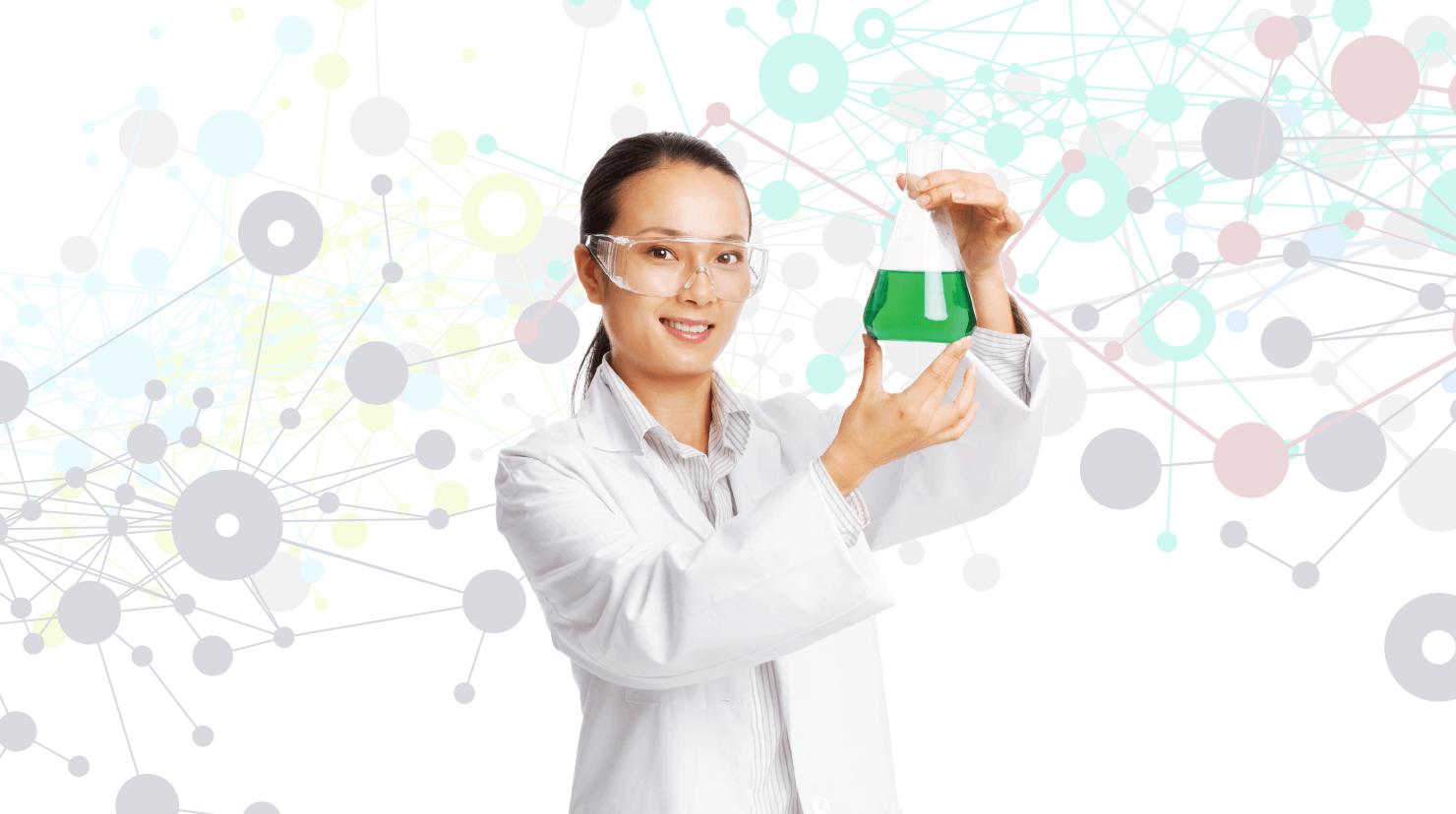 Woman in white lab coat holding beaker