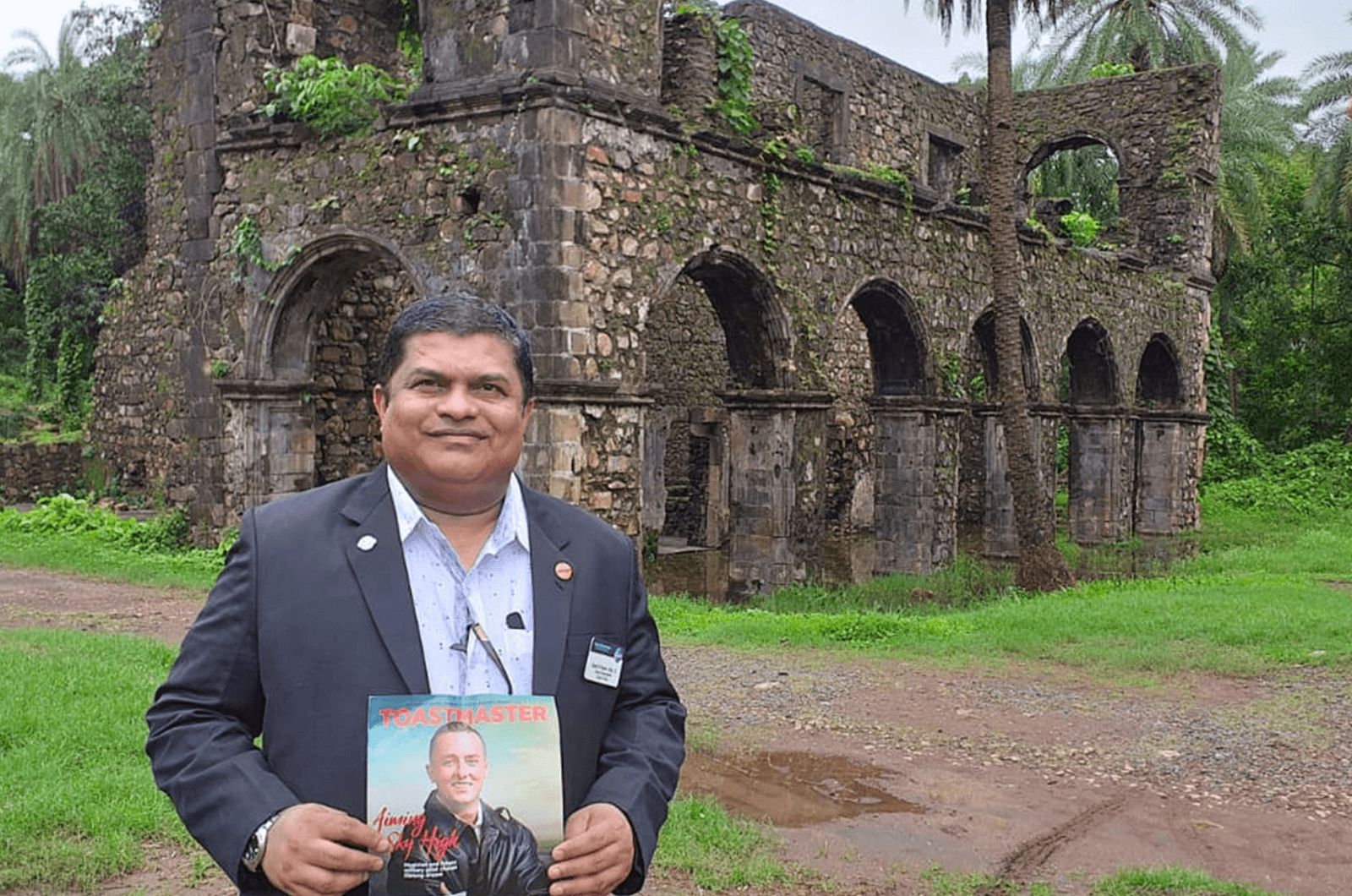 Ubedur Rehman Shaikh, of Jubail, Saudi Arabia, stands in front of Vasai Fort in Vasai, India, also known as Fort Bassein, and protected by the Archaeological Survey of India.