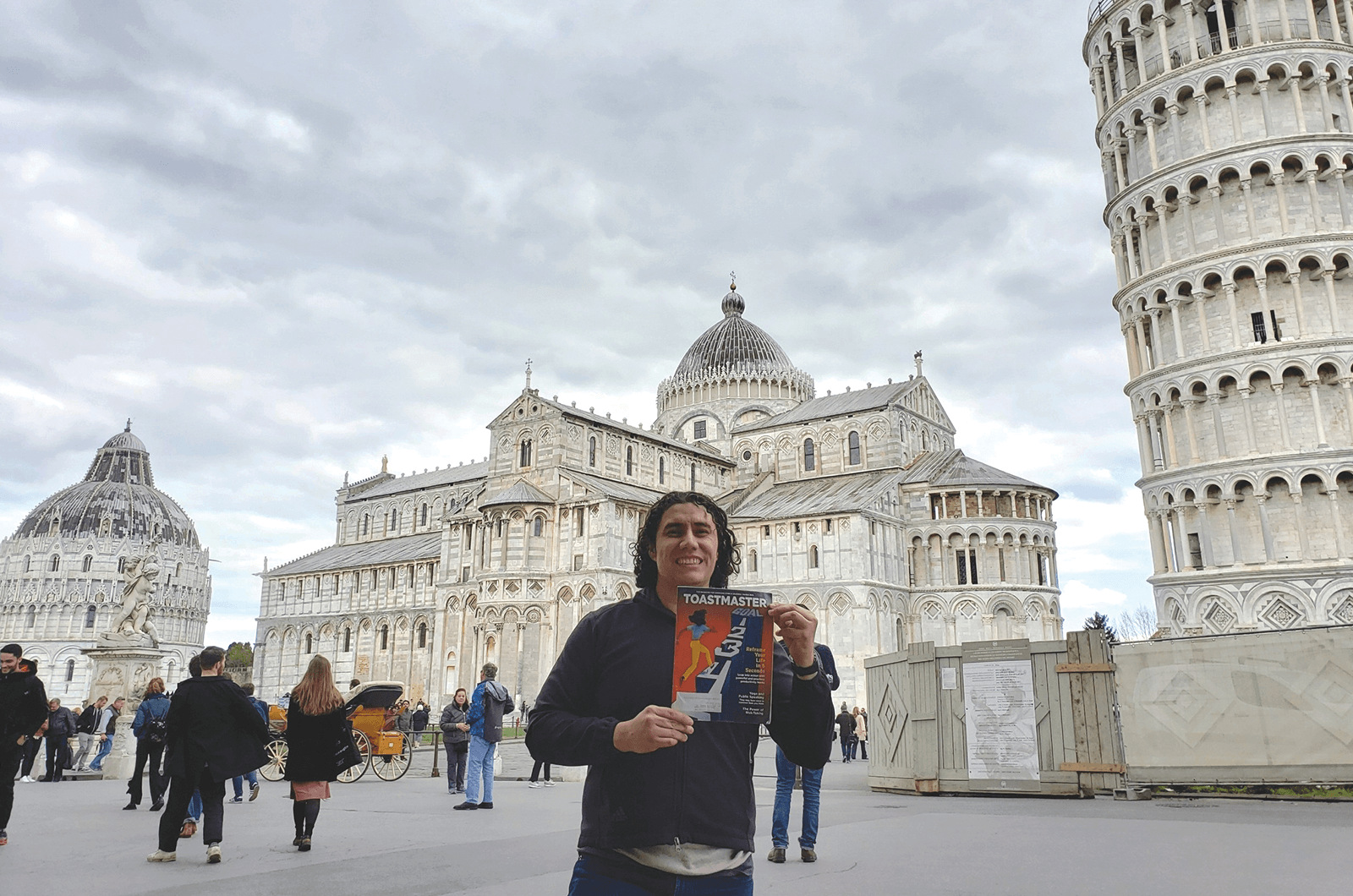 Angel Omar Sandval of Mesa, Arizona, stands in front of the Leaning Tower of Pisa and Piazza dei Miracoli in Pisa, Italy.