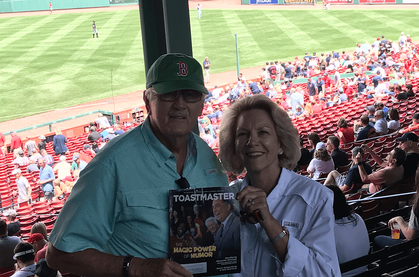 Distinguished Toastmasters Barbara and George Strasdas of Port St. Lucie, Florida, attend a Boston Red Sox baseball game in Boston, Massachusetts. Fenway Park has been home to the professional baseball team since 1912, making it the oldest ballpark in Major League Baseball.