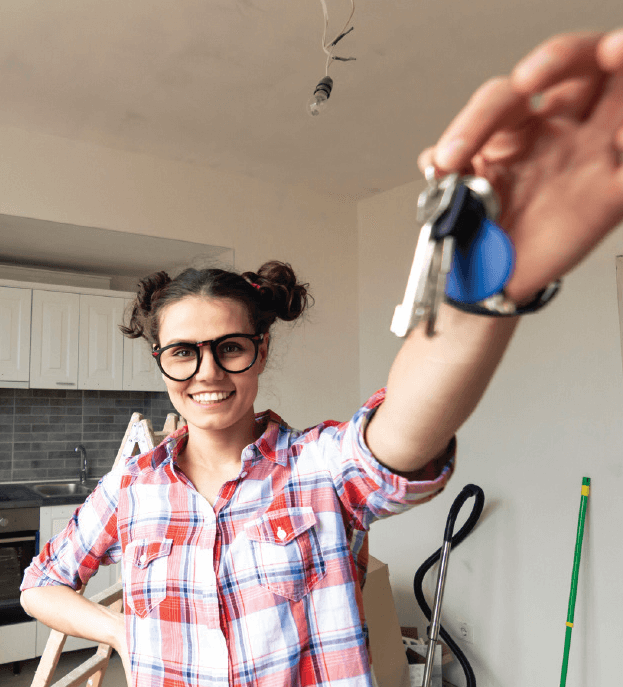 Woman holding keys to apartment