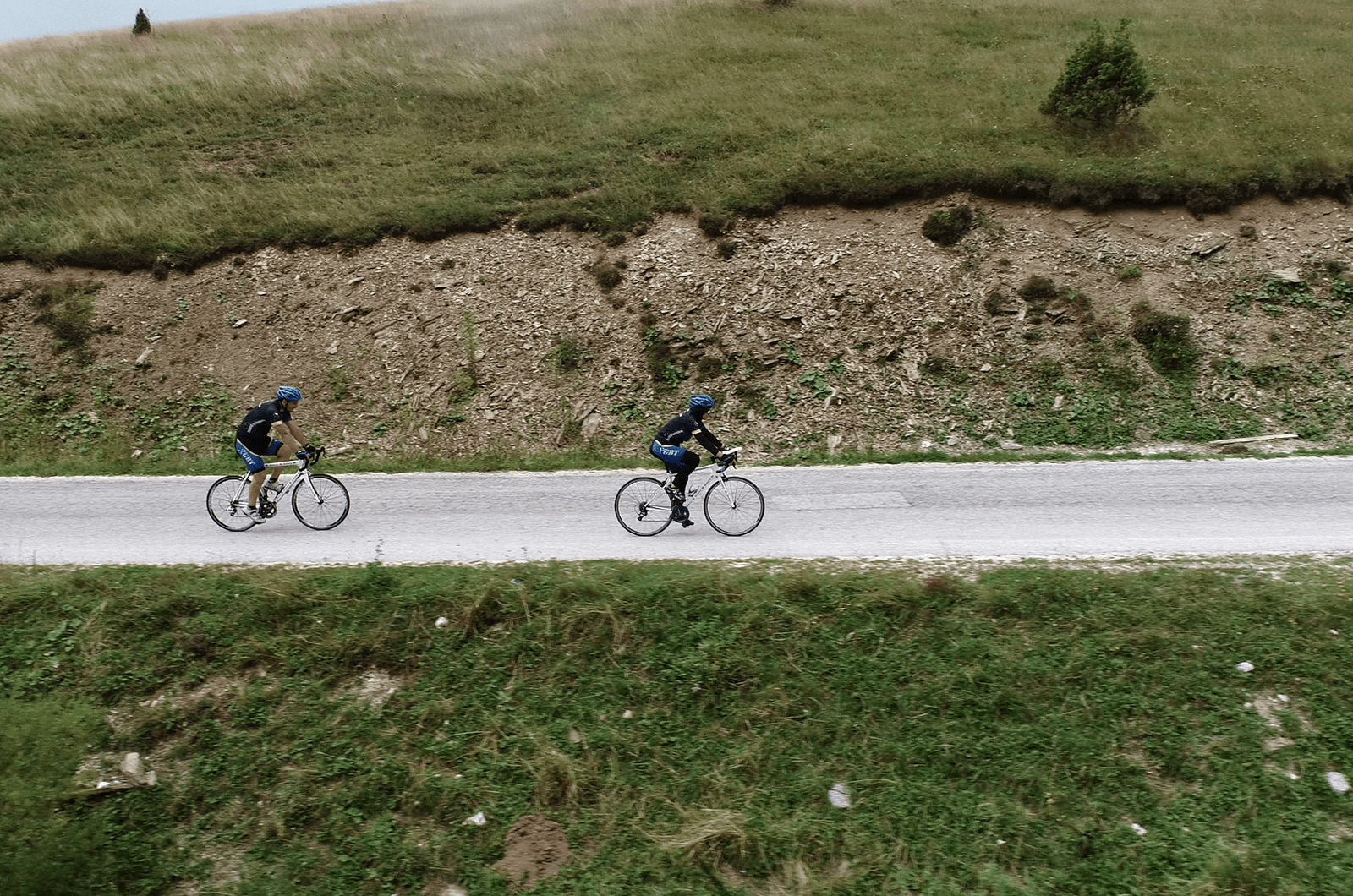 Softić (right), rides her bicycle during a triathlon.