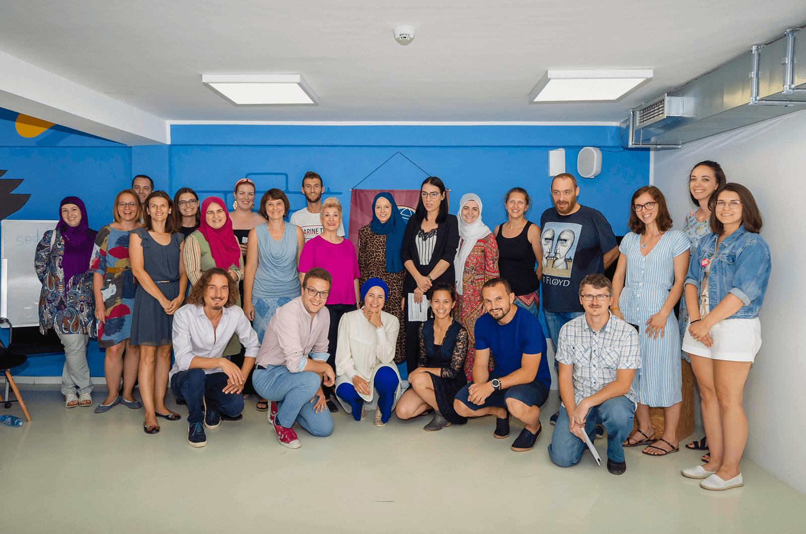 Nudžejma Softić (front row, center), poses with her fellow members of the Sarajevo Toastmasters club in Bosnia and Herzegovina.