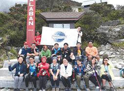 Group of Toastmasters members at Mount Kinabalu