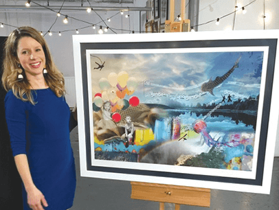Woman in blue dress standing next to painting