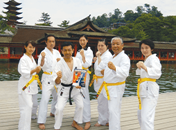 Club members pose in karate uniforms