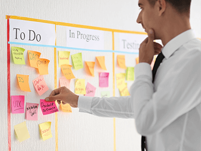 Man working on to-do list