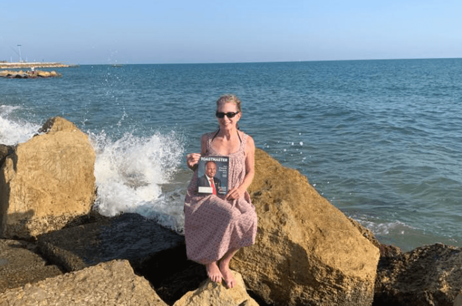Caryl Lattof of West Roxbury, Massachusetts, sits by the Mediterranean Sea in Anzio, Italy.