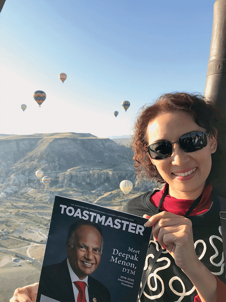 Koh Lay Hoon, DTM, of Singapore, takes her Toastmaster magazine on a hot air balloon ride in Cappadocia, Turkey.