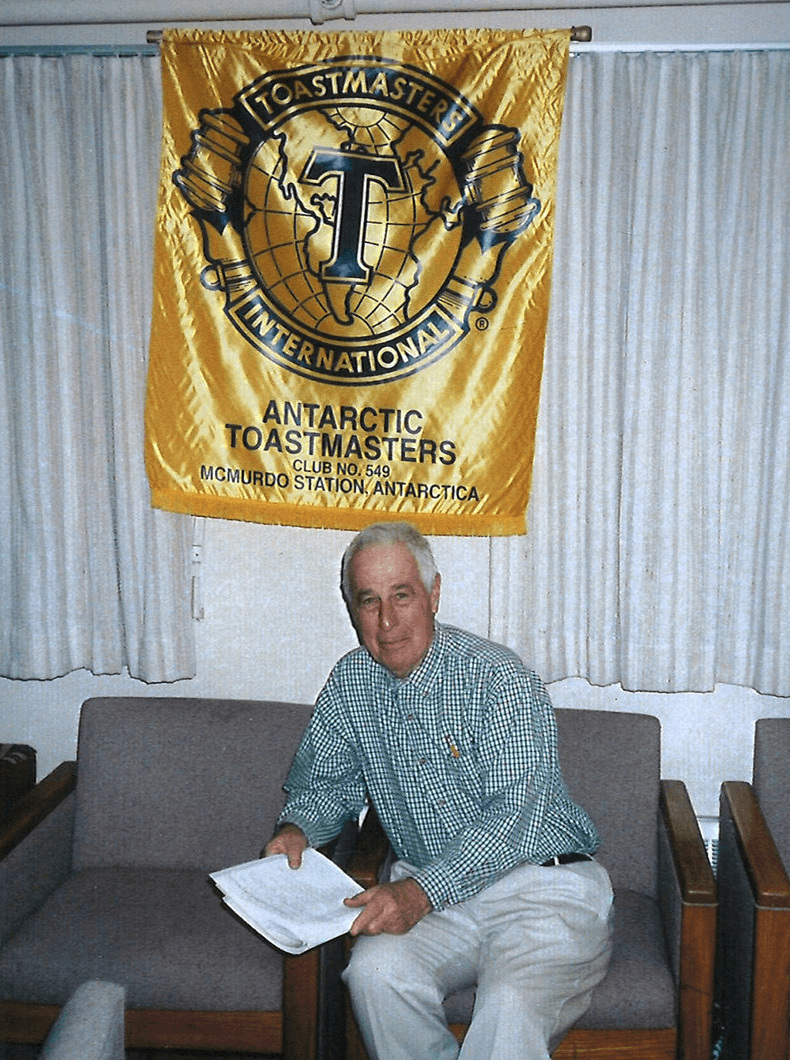 John Donnellon sits underneath the Antarctica club banner (with older branding), from when he was a member of the unique club in the 1990s.