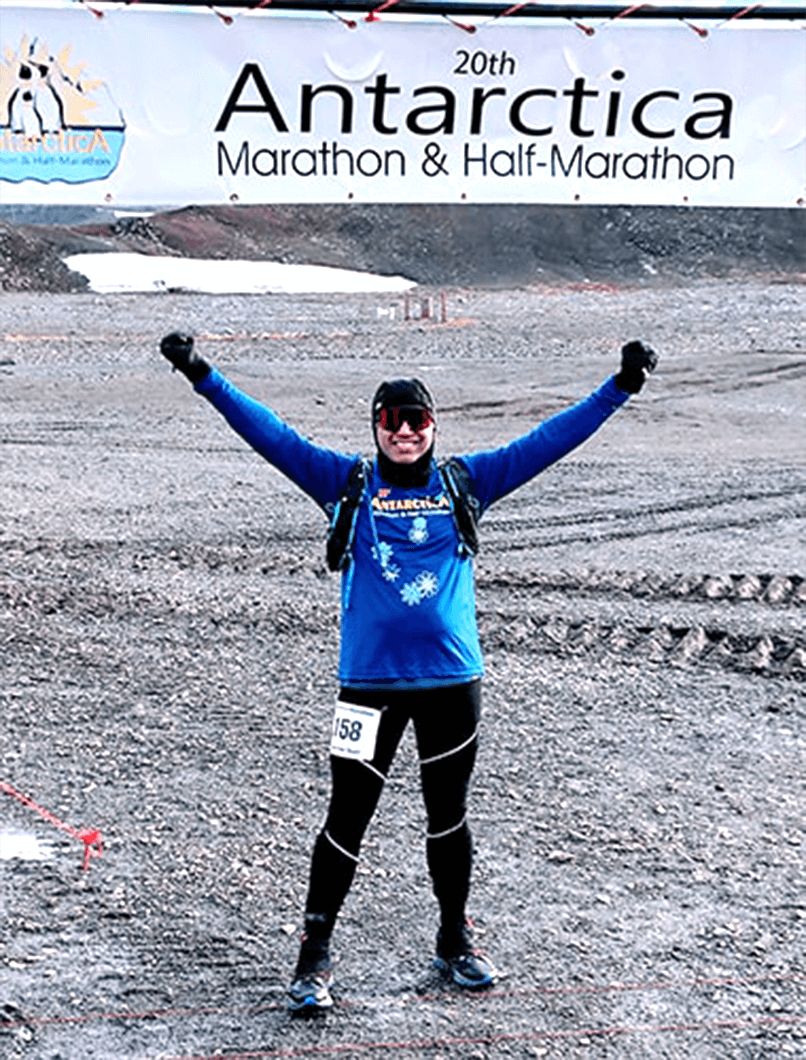 Toastmaster Satish Shenoy celebrates after completing a marathon in Antarctica.