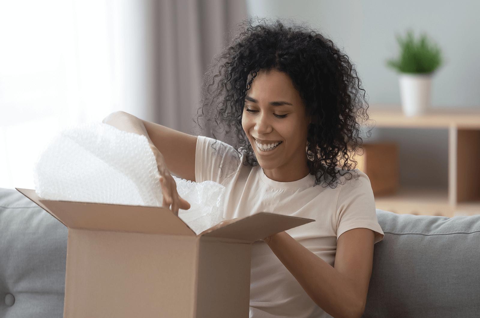 Woman opening box