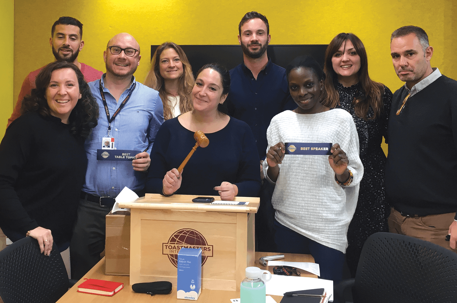 Group of Toastmasters with lectern and gavel