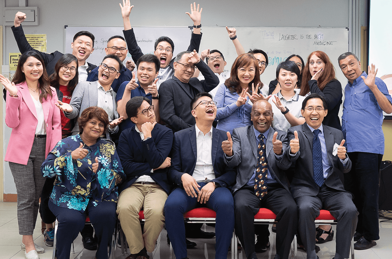Group of Toastmasters with their hands in the air