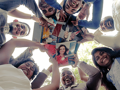 Toastmasters members looking down at camera holding manuals