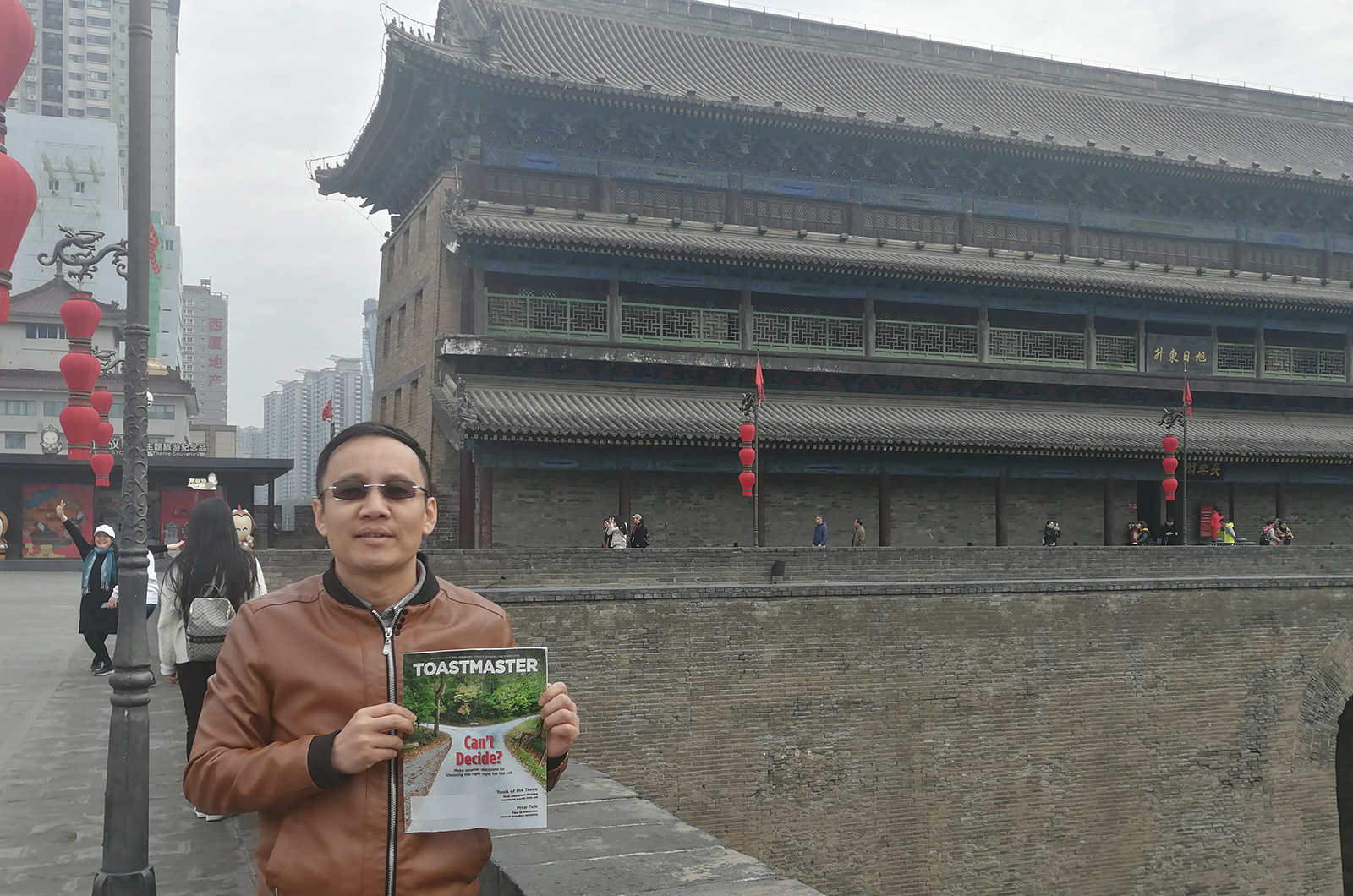 Billy Shi, DTM, of Shanghai, China, poses on the ancient city wall in Xi'an, China.